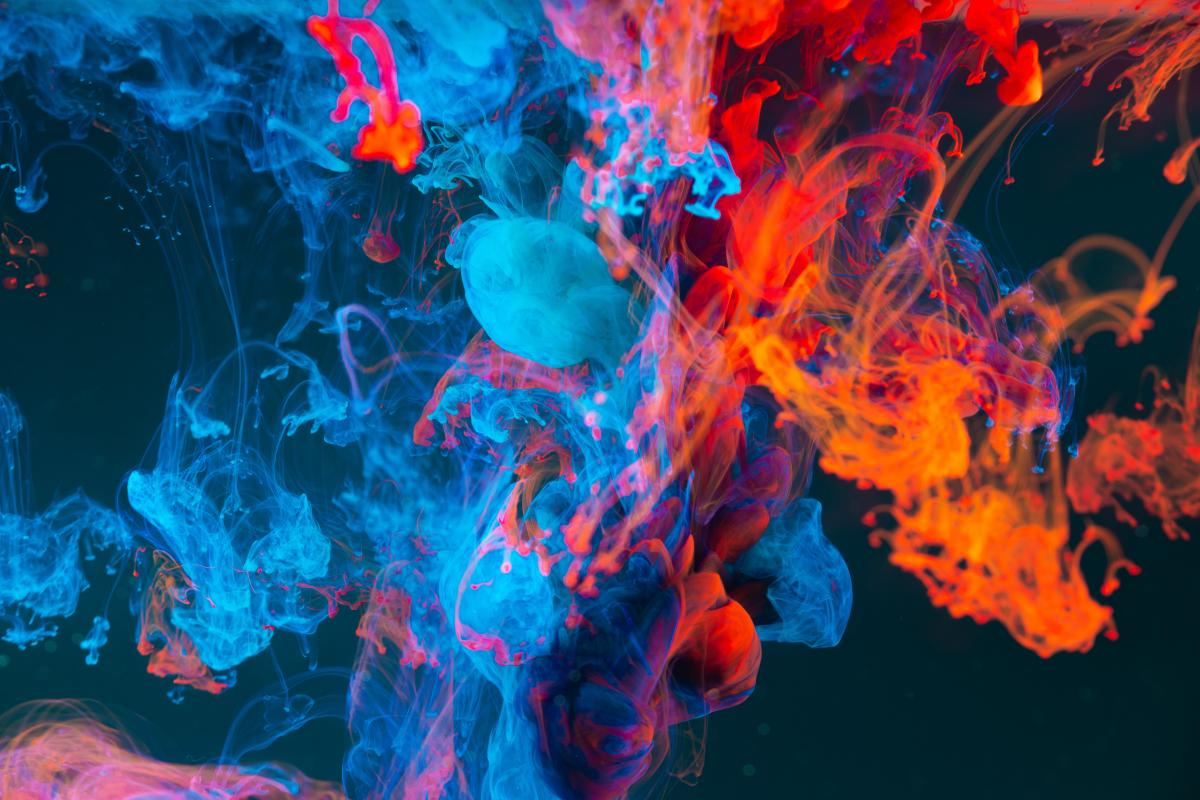 Abstract blue and orange smoke on a black background