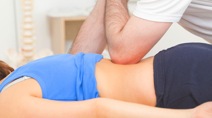 Practitioner performing chiropractic techniques.