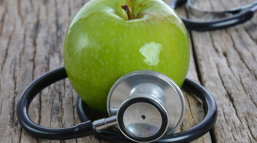 Apple and stethoscope.